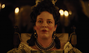 screencap of Olivia dressed as the Queen in the Favourite